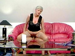Granny in tan stockings taking